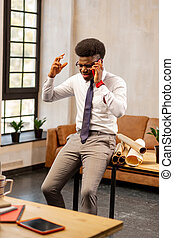 Nice young man speaking on the phone