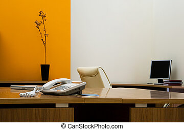 phone on a desk in a modern office