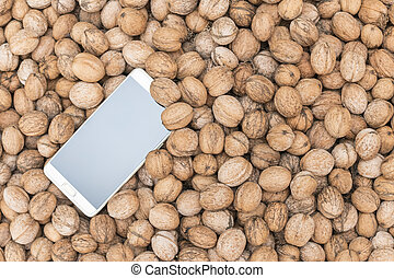 Phone on a pile of nuts