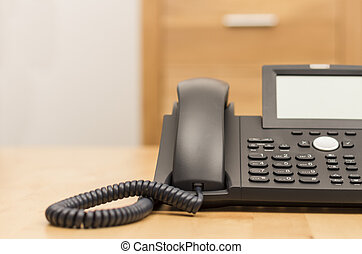 phone on desk with blurred background