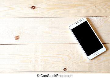 Phone on wood table