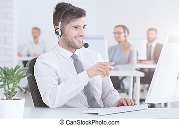 Phone operator talking with customer - Handsome positive...