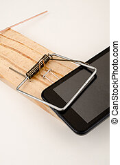 Phone overuse - Mousetrap closed on a smartphone, a concept...