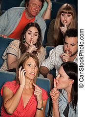 Phone Silence In Theater - Loud woman on phone annoys people...