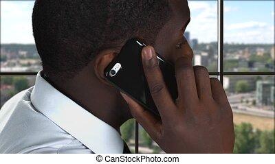 Phone talk on city background.