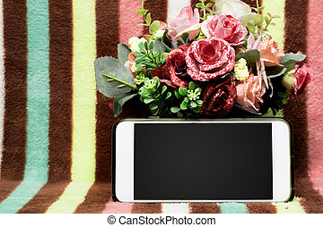 phone with copy space and bouquet of flowers