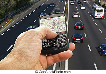 phone with GPS close up with an highway on the background