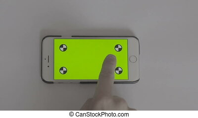 Phone with green background
