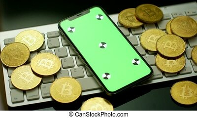 Phone with green screen and bitcoins