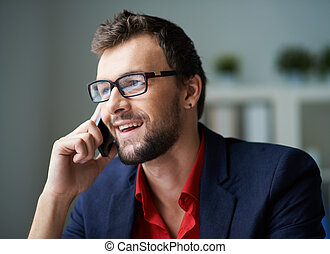 Phoning client - Handsome businessman in smart casual and...