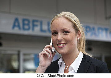 phoning with mobile phone at the airport
