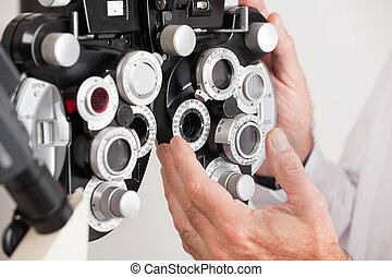 Phoropter For an Eye Examination - Optometrist changing...