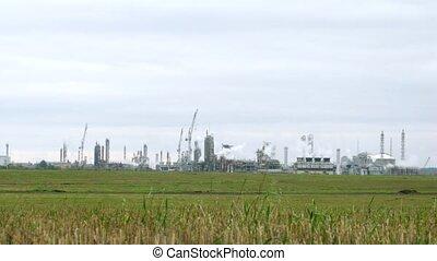 Phosphoric factory stands far against blue sky