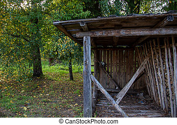Photo a barn with dry chopped wood.