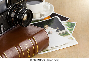 photo album and old camera with coffee