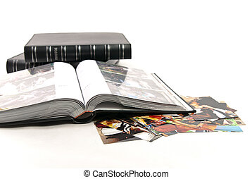 photo albums and opened album with photos isolated on white...