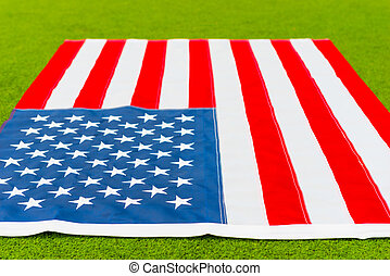 Photo American flag close-up on grass