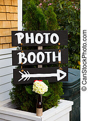 Photo Booth Wedding Sign - A handmade sign reads photo booth...