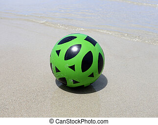 photo bright rubber ball on the beach