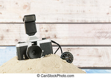 Photo camera and compass for travel around the world