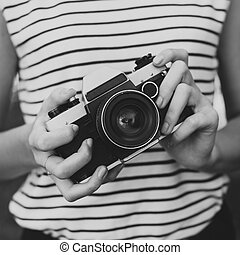 Photo camera in the hands of the girl