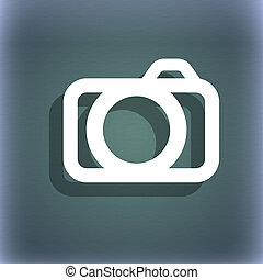 Photo camera sign icon. Digital photo camera symbol. On the blue-green abstract background with shadow and space for your text.