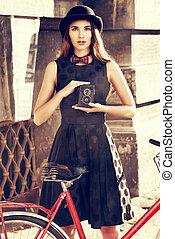 photo camera - Beautiful brunette standing near her old...