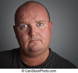 dark portrait photo of depressed down male