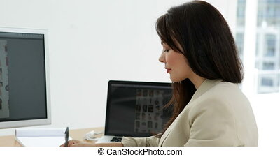 Photo editor choosing photos on computer screen in creative...