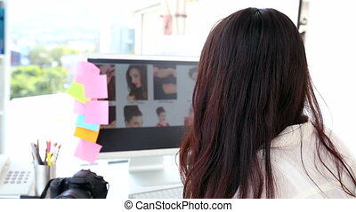 Photo editor working at her desk - Photo editor working at...