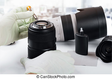 photo equipment service and repair, technician doing camera lens maintenance