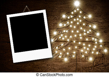 Photo frame Christmas tree wooden background