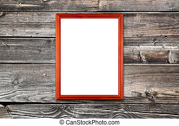 Photo frame hanging on wooden wall