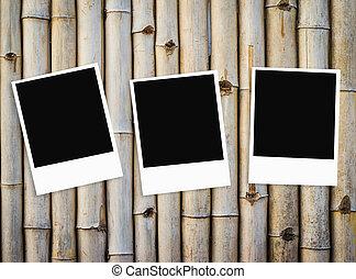 Photo frame on old bamboo fence background