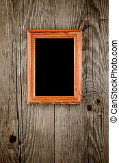 Photo frame on old wooden background