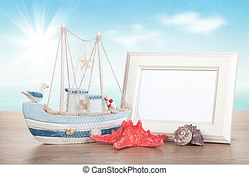 Photo frame on wood table - Photo frame, starfish, seashell...