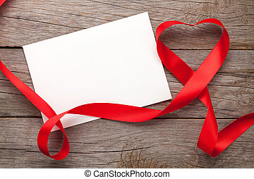 Photo frame or gift card with valentines heart shaped ribbon...