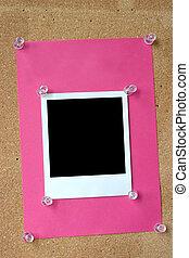 photo frame thumbtacked to cork board