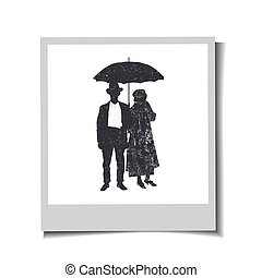 Photo-frame with silhouettes old-fashioned women and man