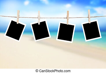 Photo frames hanging on a rope