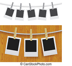 Photo frames with pins on rope over old aged wood background...