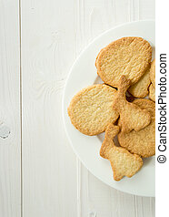 Photo from above of dish with cookies on white desk
