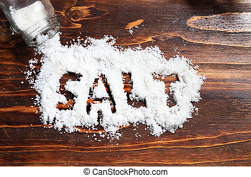illustration for healthy life style, spilled salt at wooden board