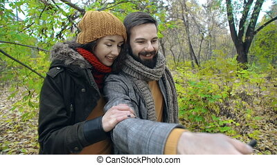 Photo in a Park - Close up of two sweethearts taking selfie...
