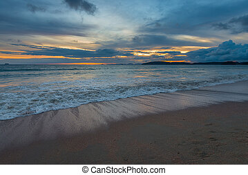 Photo in blue tones, sunset over the Andaman Sea in Thailand