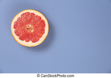Photo kinds of pop art. Grapefruit on a blue background