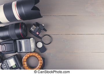photo lenses and accessories on wooden background with copy space