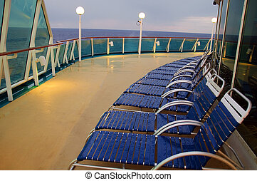 lounge chairs in a row on a ocean cruise ship