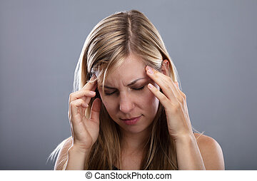 Woman Suffering From Headache - Photo O Blonde Young Woman...