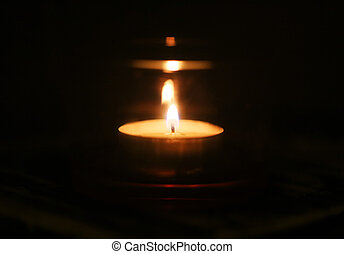 Photo of a candle in the dark